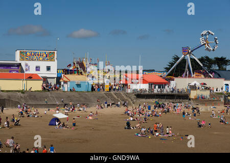 Sandy bay and Coney Beach on a busy warm weekend afternoon in August - Stock Photo