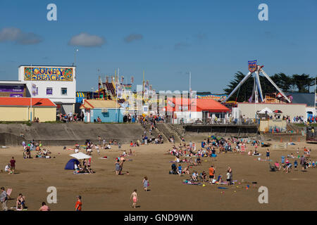 Sandy bay and Coney Beach on a busy warm Saturday afternoon in August - Stock Photo
