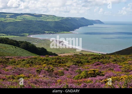 View from Bossington Hill looking across Porlock Bay towards Porlock Weir with the hills of Exmoor in the distance - Stock Photo