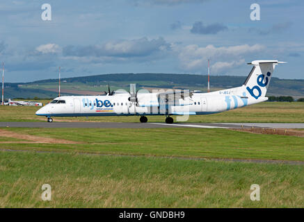 FlyBe Bombardier Dash 8 Q400 arriving at Inverness Airport in North East Scotland.  SCO 11,210. - Stock Photo