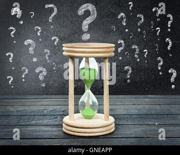 Question marks close-up on wooden table - Stock Photo