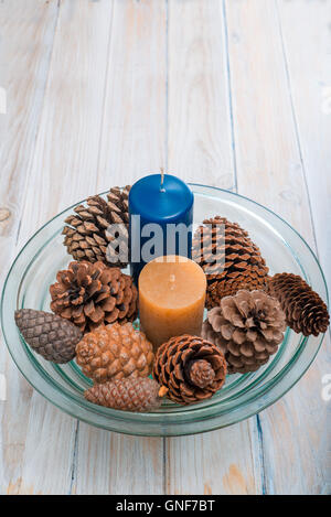 center table with Christmas candle and pine cones.  Copy space - Stock Photo
