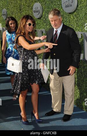 FLUSHING NY- AUGUST 29: Alec Baldwin and Hilaria Baldwin arrive during opening night ceremonys on Arthur Ashe Stadium - Stock Photo