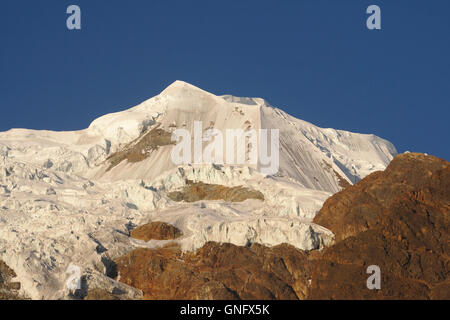 Illimani (side peak) from Base Camp in evening light, Cordillera Real, Bolivia - Stock Photo