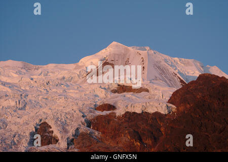 Illimani (side peak) from Base Camp, sunset afterglow, Cordillera Real, Bolivia - Stock Photo