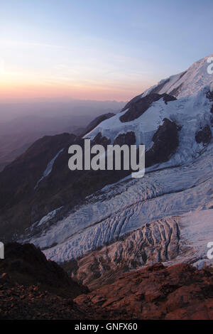 Glaciers on Illimani seen from High Camp, sunset, Bolivia - Stock Photo