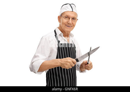 Elderly butcher sharpening his knife isolated on white background - Stock Photo