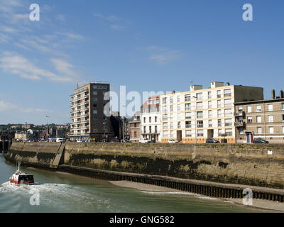 Entrance to inner harbour from Quai de la Marne, Dieppe, France with vessel P'tit Fredo in foreground - Stock Photo