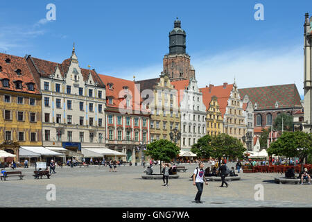 Pedestrian of the Market Square in the historical Old Town of Wroclaw with view of the St. Elizabeth's Church - - Stock Photo