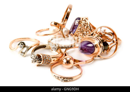 rings made of precious metals and precious stones isolated on white background - Stock Photo