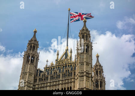 Union Flag flying over Victoria Tower, Houses of Parliament. London, UK - Stock Photo