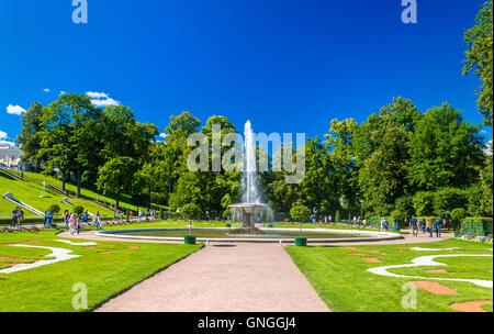Big French fountain in Peterhof Garden - Russia - Stock Photo