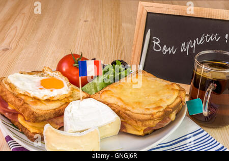 French dish with message on chalkboard - Stock Photo