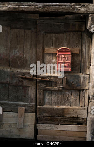 Mail box mounted on a dilapidated door, Orvieto, Terni Province, Umbria, Italy - Stock Photo