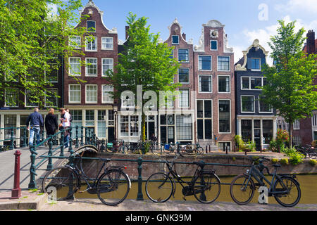 Bicycles and canalside gabled houses - Dutch gables - Milkmaid's Bridge Melkmeisjesbrug on Brouwersgracht in Amsterdam, - Stock Photo