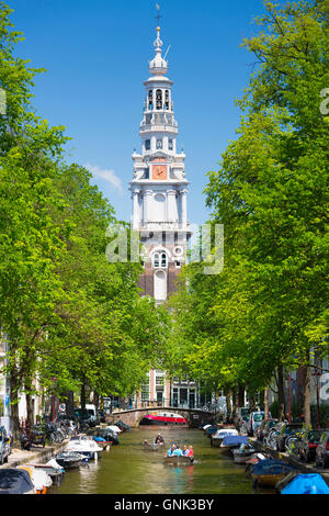 Zuiderkerk in Old Town and tourist boat taking tour cruise group sightseeing on Dutch canals, Groenburgwal, Amsterdam, - Stock Photo