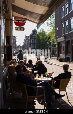 Local people drinking at bar corner of Elandsgracht and Prinsengracht in Jordaan district of Amsterdam, Holland - Stock Photo