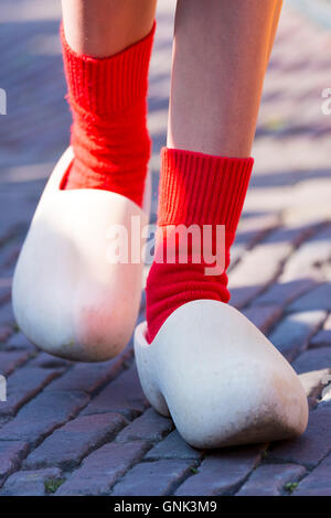 Dutch clogs traditional shoes and socks worn by woman Kaasmeisje, Alkmaar cheese market, The Netherlands - Stock Photo