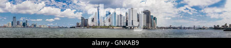 A large panoramic view spanning the New York harbor. Manhattan's Financial district is in the center, Jersey City - Stock Photo