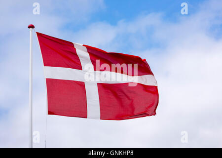 Danish flag on flagpole in Denmark - Stock Photo