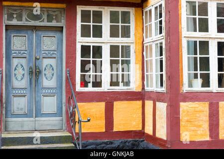 Painted door of Den Gamle Gaard Museum in 18th Century in Torvegade at Faaborg on Funen, Denmark - Stock Photo
