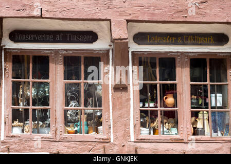 Half-timbered shop in Nedergade in Odense on Funen Island, Denmark - Stock Photo