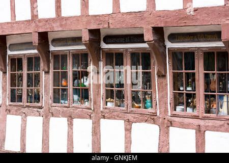 Half-timbered shop in Nedergade in Odense on Funen Island, Denmark - Stock Photo