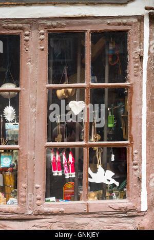 Window of shop in Nedergade in Odense on Funen Island, Denmark - Stock Photo