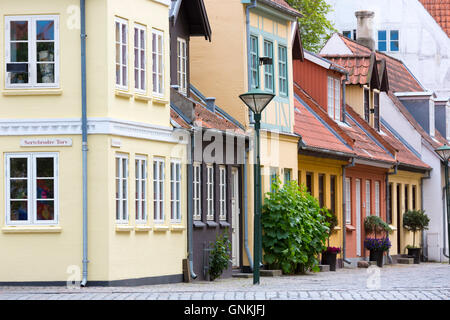 Painted houses in the old town in Odense on Funen Island, Denmark - Stock Photo