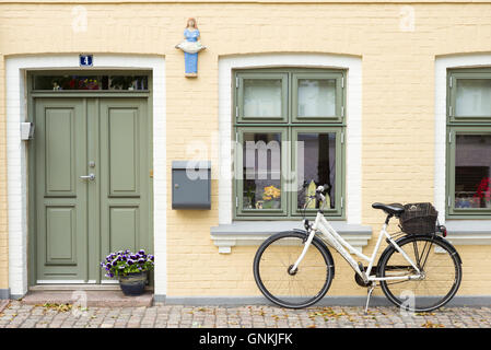 Painted house and bicycle in Sortebrodre Torvet in the old town in Odense on Funen Island, Denmark - Stock Photo