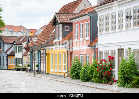 Painted houses in Ramsherred in the old town in Odense on Funen Island, Denmark - Stock Photo