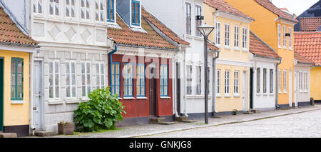Painted houses in Ramsherred cobbled street in old town in Odense on Funen Island, Denmark - Stock Photo