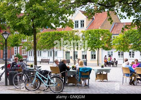 Al fresco dining at street cafe restaurant in Gront Torvet square in old town Odense on Funen Island, Denmark - Stock Photo
