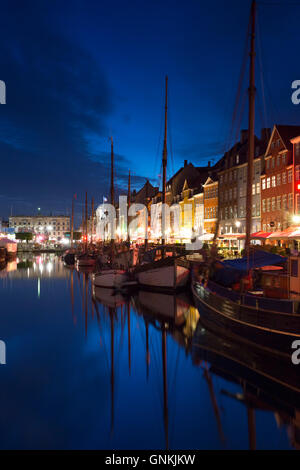 Nightlife in the famous Nyhavn, old canal harbour in Copenhagen on Zealand, Denmark - Stock Photo