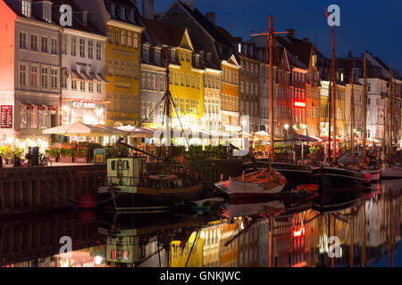 Nightlife in the famous Nyhavn, , old canal harbour in Copenhagen on Zealand, Denmark - Stock Photo