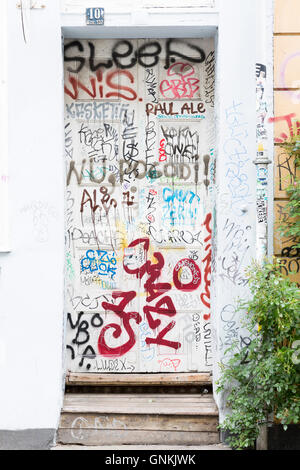 Graffiti in the old district of Copenhagen, Denmark - Stock Photo