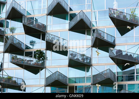 Glass balcony modern architecture new high rise homes development Orestads Boulevard in Orestad City area, Copenhagen, - Stock Photo