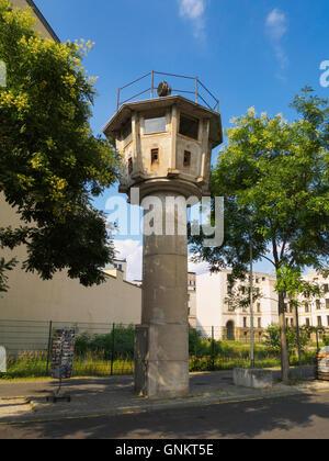 Preserved old East German DDR Berlin wall watchtower near Potsdamer Platz Berlin Germany - Stock Photo