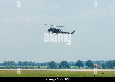 Demonstration flight of military helicopter Bell UH-1 Iroquois. German Army - Stock Photo