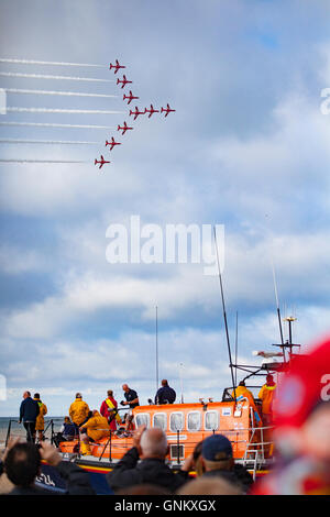 Rhyl Air Show 2016 located on the North Wales coast and held every year. The RAF Red Arrows fly over the RNLI Lift - Stock Photo