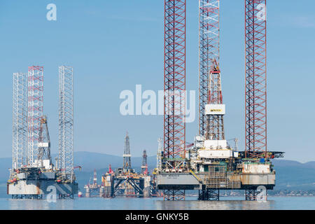 Oil rigs / drilling platforms moored in Cromarty Firth in Ross and Cromarty, Highland, Scotland, United Kingdom - Stock Photo