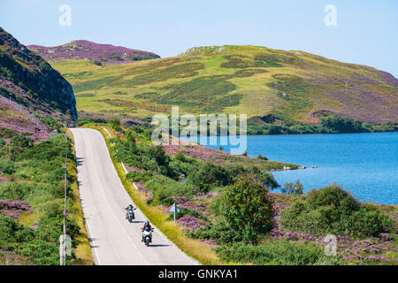 Remote highway A894 part of North Coast 500 tourist route, in Highland Region, near Scourie north Scotland in summer,United - Stock Photo