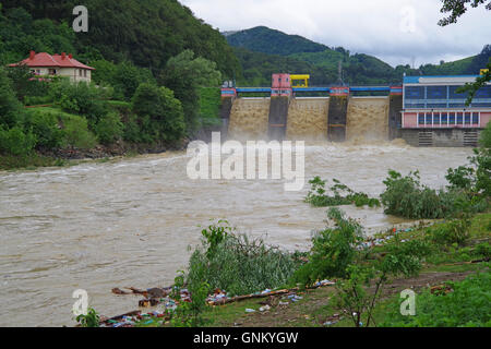 Dam flood after storm on Bistrita river, rainy season. - Stock Photo