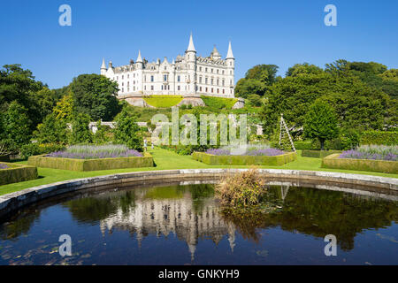 Dunrobin Castle with pond and gardens at Golspie, Highland, Scotland. Castle is seat of the Earl of Sutherland and - Stock Photo