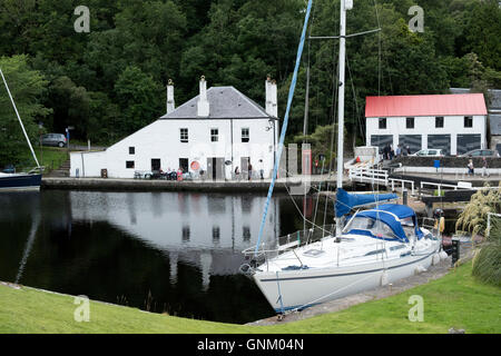 View of basin with yacht on Crinan Canal in Argyll and Bute in Scotland, United Kingdom - Stock Photo