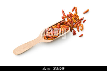 Dried mini chili peppers in wooden scoop. Isolated on white background. - Stock Photo