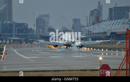 British Airways BACityfler Embraer 170 passenger plane lands at London City Airport in the Docklands - Stock Photo