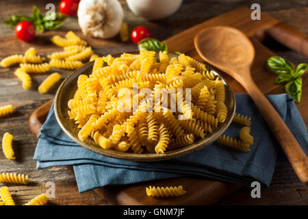 Raw Dry Organic Fusilli Pasta Ready for Cooking - Stock Photo