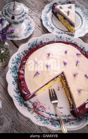 Cake with cream cheese and mascarpone coloring with blueberry - Stock Photo