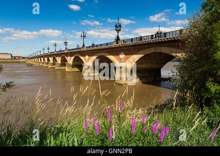 Pont de Pierre. Stone Bridge & Garonne River. Bordeaux, Gironde. Aquitaine France Europe - Stock Photo
